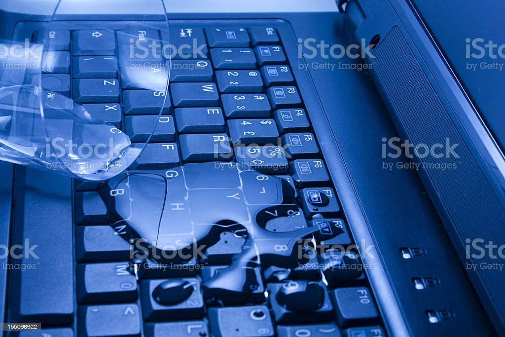 Water poured on laptop stock photo