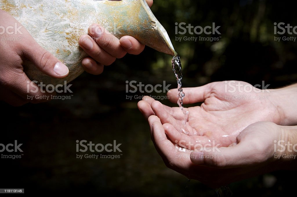 water poured out - servanthood stock photo