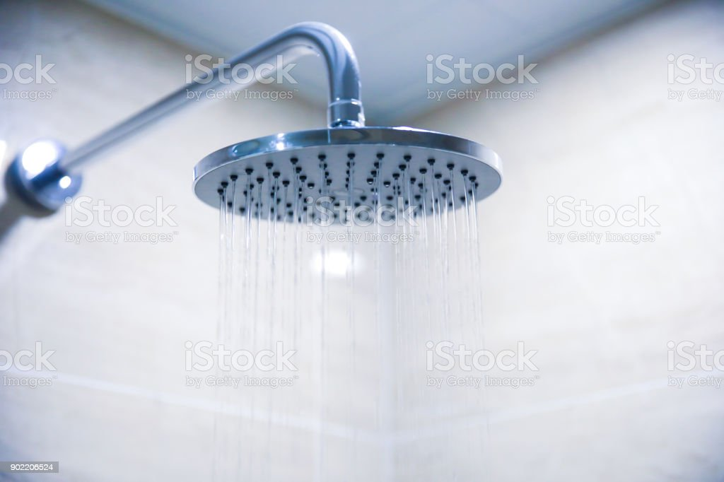 Water Pouring From A Shower Head Stock Photo & More Pictures of ...