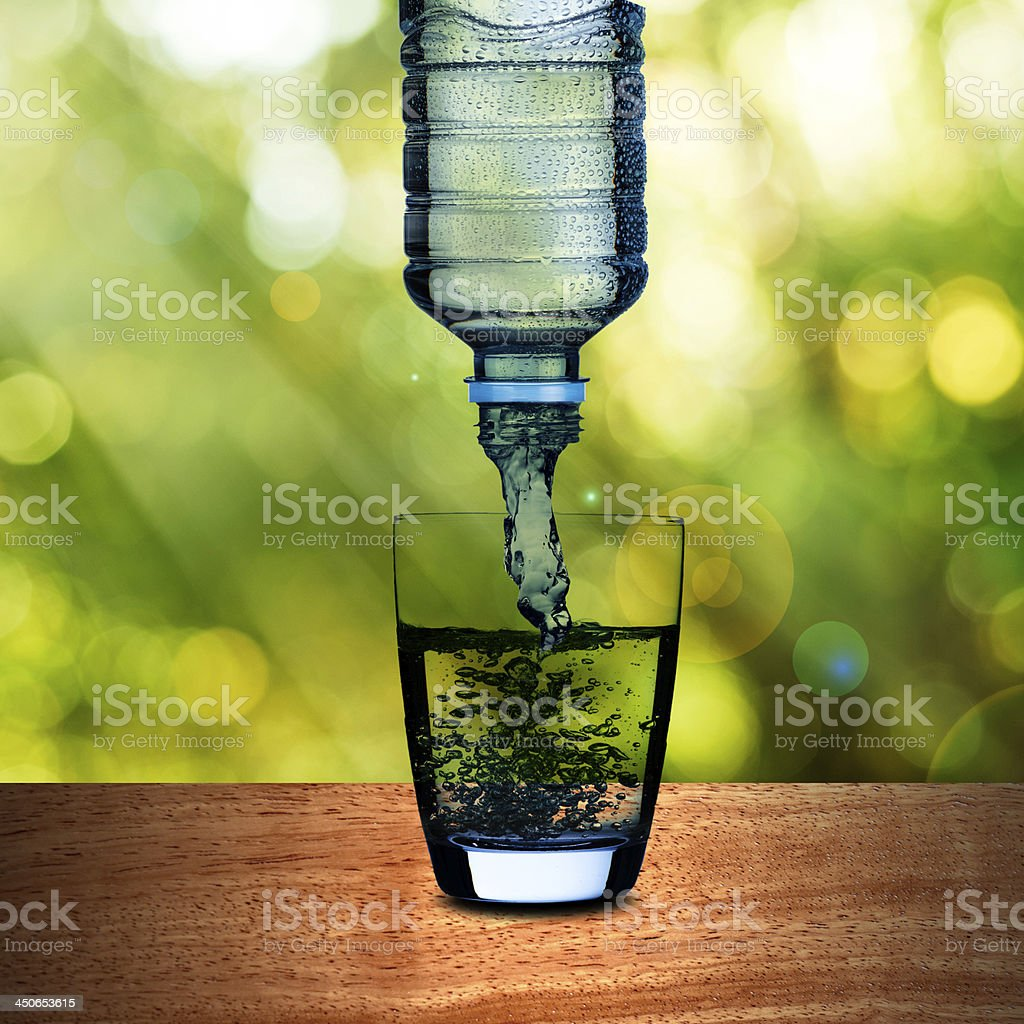 Water pouring from bottle royalty-free stock photo