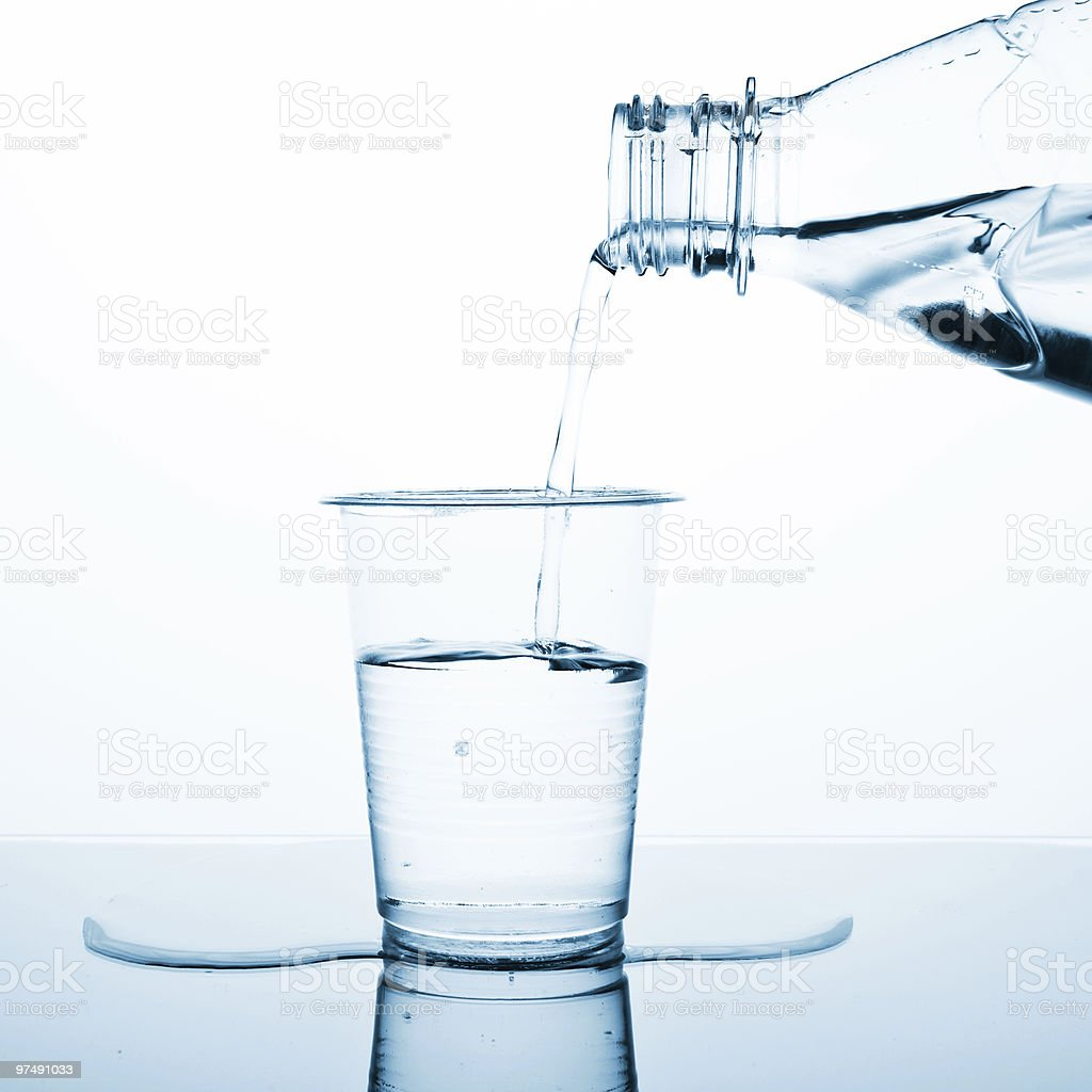 Water pouring in plastic glass royalty-free stock photo