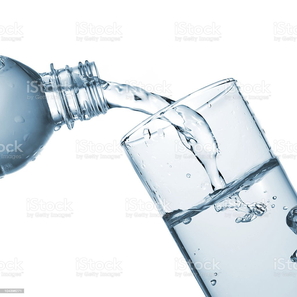 water pouring into glass from bottle royalty-free stock photo