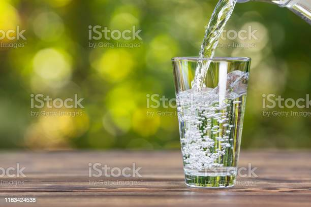 Photo of water pouring into glass