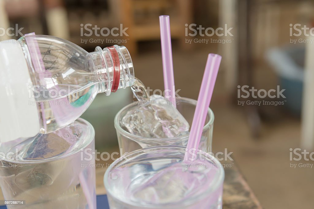 Water pouring on a plain glass royalty-free stock photo