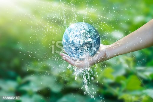 istock Water pouring on planet earth placed on human hand for saving resources and heal the world campaign, environment issues, Elements of this image furnished by NASA. 873806412