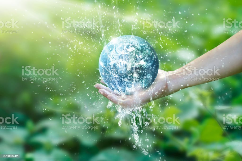 Water pouring on planet earth placed on human hand for saving resources and heal the world campaign, environment issues, Elements of this image furnished by NASA. stock photo