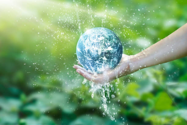 water pouring on planet earth placed on human hand for saving resources and heal the world campaign, environment issues, elements of this image furnished by nasa. - water born nature imagens e fotografias de stock