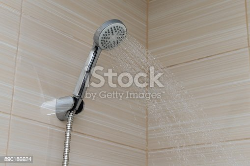 istock water pours from the shower foliage in the bathroom 890186624