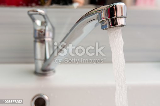 Water pours more pressure from the mixer in the bathroom
