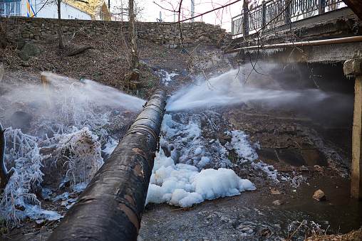Water Pressure From A Large Pipe Over The River Stock Photo - Download Image Now