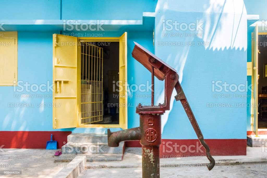 Water Pump Outside Colorful House Stock Photo - Download