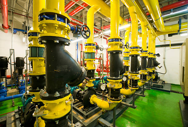 water pumping station and industrial interior pipes - radiobuis stockfoto's en -beelden