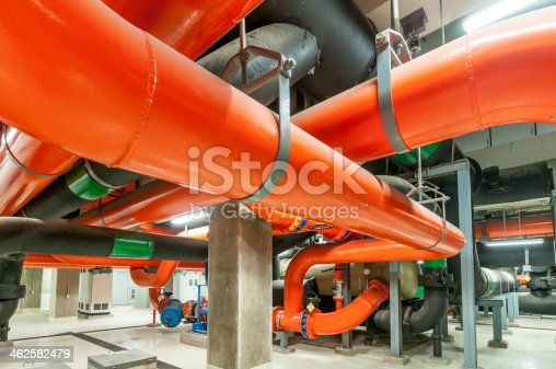istock Water pumping station, industrial interior and pipes  . 462582479