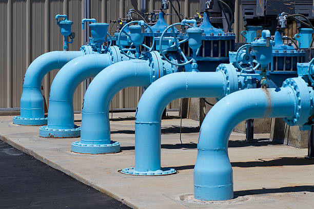 Water Pumping Transfer Station Horizontal CU Shot in Riverside, California in April of 2015. sewage treatment plant stock pictures, royalty-free photos & images
