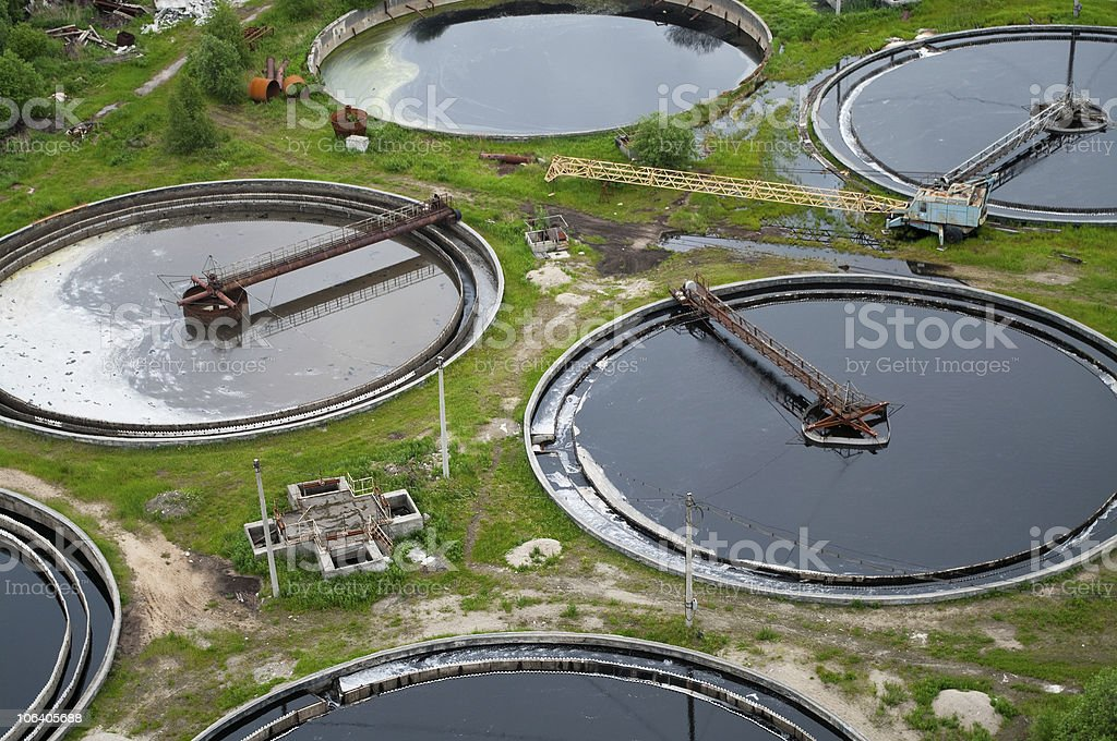 Water recycling, settling, purification in tank on industrial station. royalty-free stock photo