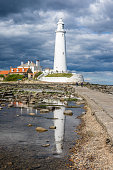 Whitley Bay, England. 22.05.19. View of St Mary's Lighthouse on the seafront of Whitley Bay with Reflections in the Water