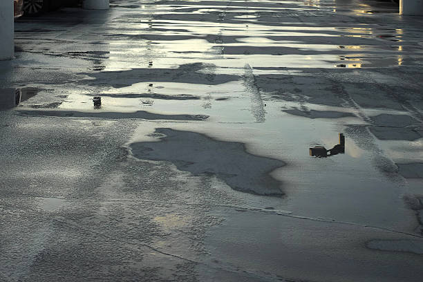 Water Reflection On Road After Rain With Sunlight stock photo