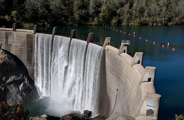Water Reservoir Dam Wall Rocks Concrete FUll Drinking Drought stock photo