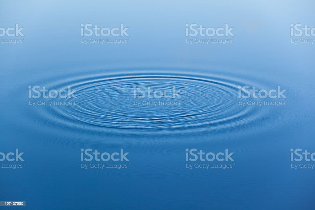 Water ripples on the surface of smooth water stock photo