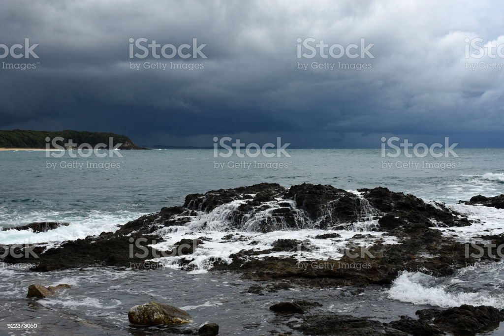 Water runoff from rocks after wave stock photo