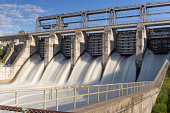 Water rushing through gates of hydroelectric station