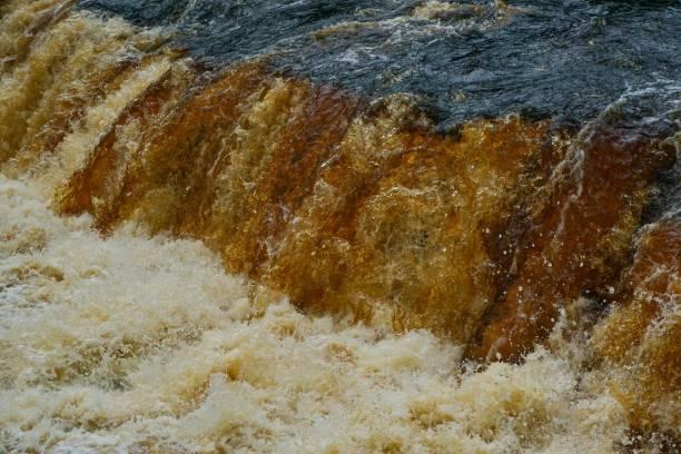 Water rushing through river stock photo