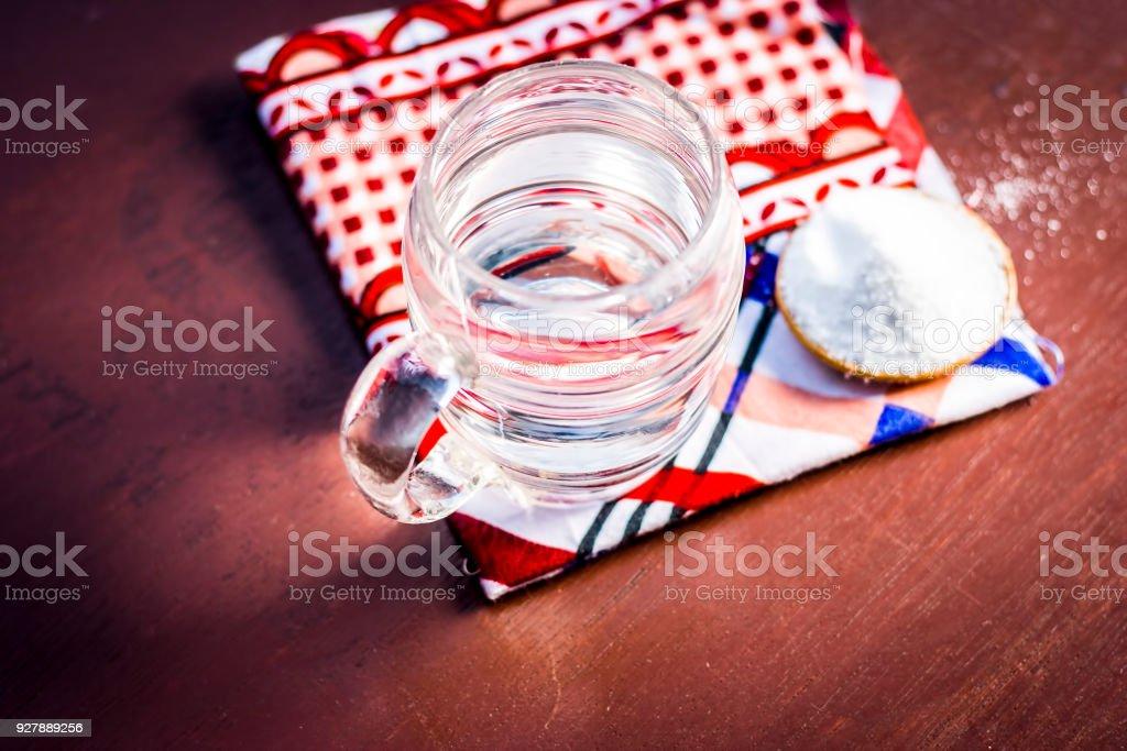 Water & salt,sodium chloride on wooden surface. stock photo