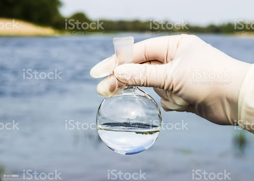 A water sample from the river. Water intake. Water abstraction. stock photo
