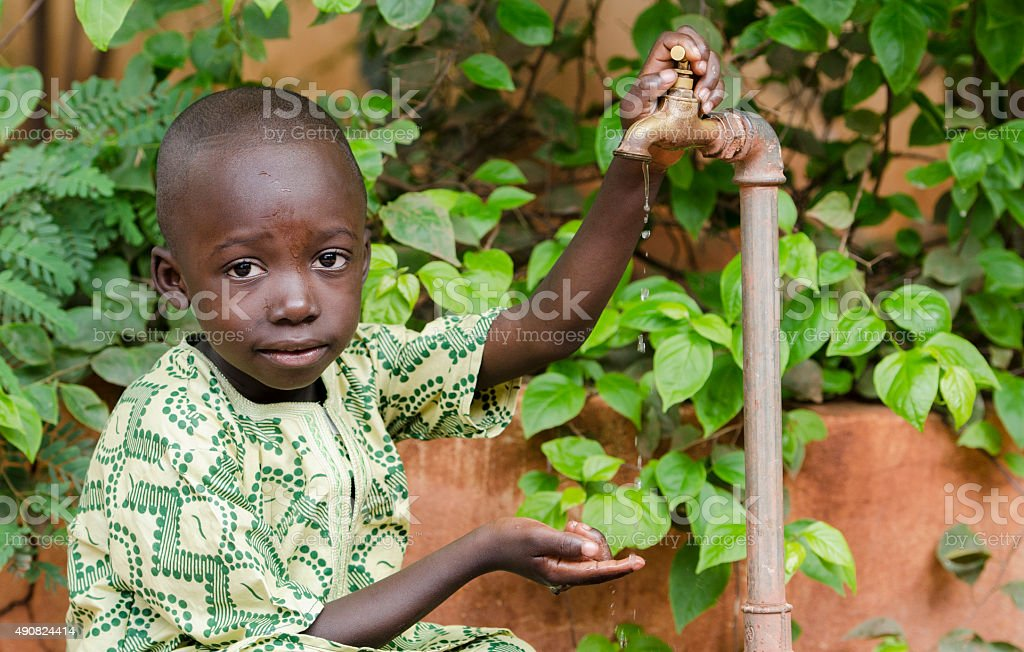 Water Scarcity Symbol in Africa - Finger Under Tap stock photo