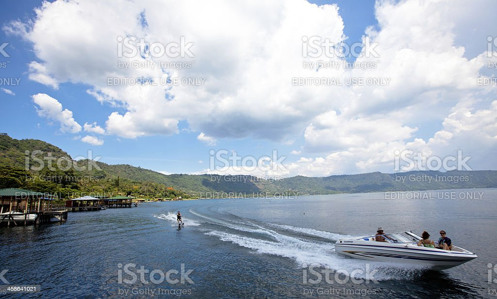 Water skiing on Lago de Coatepeque (Crater lake) El Salvador royalty-free stock photo