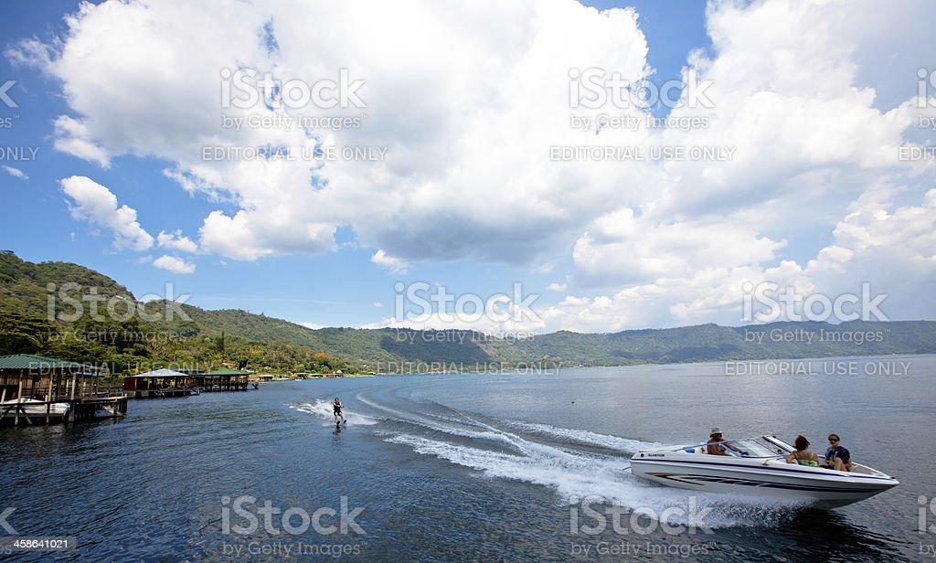 Water skiing on Lago de Coatepeque (Crater lake) El Salvador stock photo