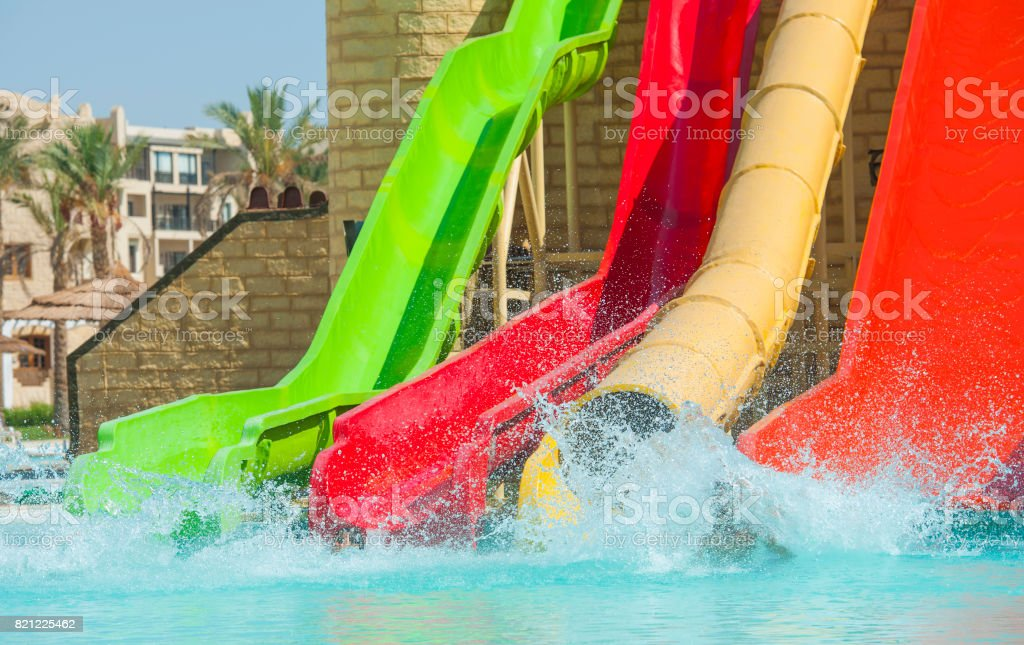 Water slides at a large swimming pool in luxury tropical hotel stock photo