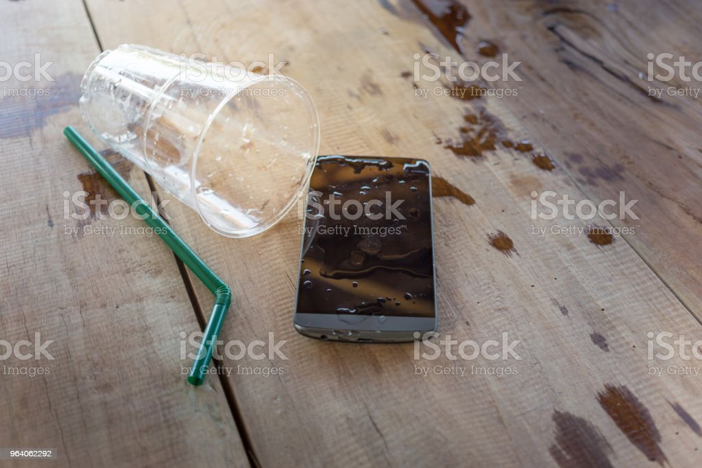 water spilled on mobile phone - Royalty-free Biological Cell Stock Photo