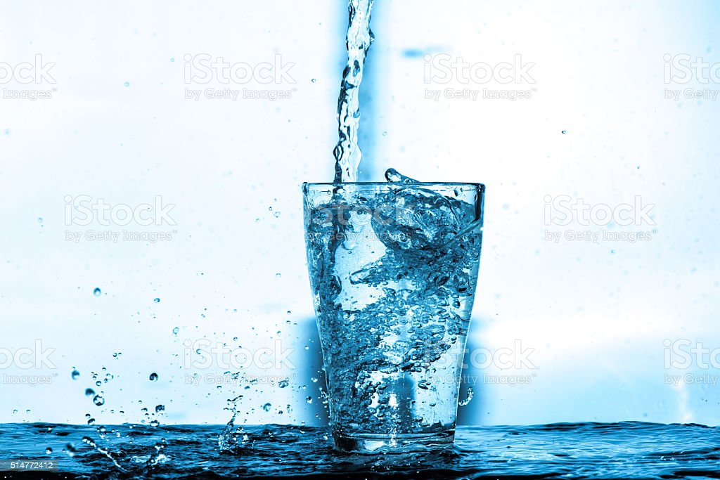 water splash in a glass stock photo