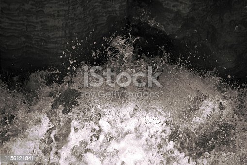 istock Water splash in black and white. Darkness ans shadow. Water in dynamic motion. Monochrome abstract background. Dynamism and energy concept. 1156121841