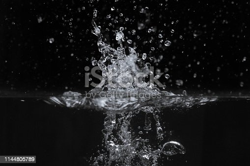 134949478 istock photo Water splash isolated on black background 1144805789