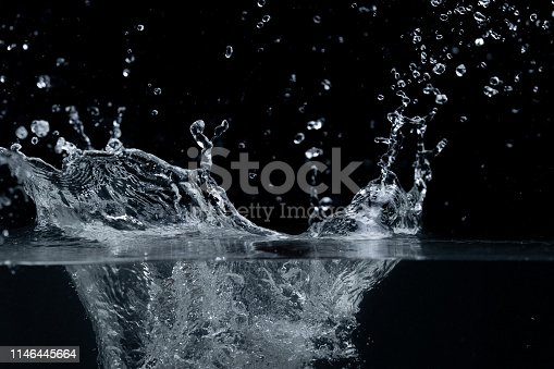 134949478 istock photo Water splash isolated on black background 1146445664