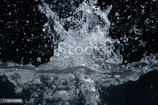 134949478 istock photo Water splash isolated on black background 1146445686