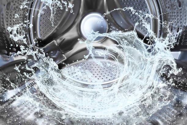 water splash of the washing machine drum - стирка стоковые фото и изображения