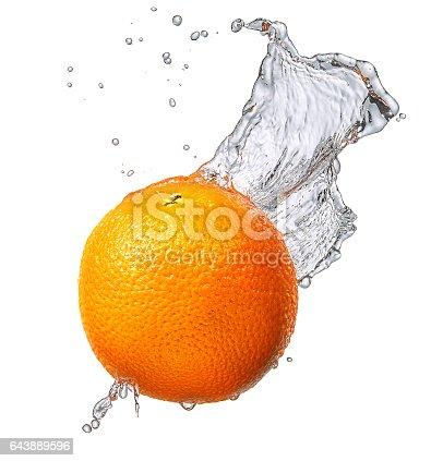 858282944 istock photo Water splash with orange isolated 643889596