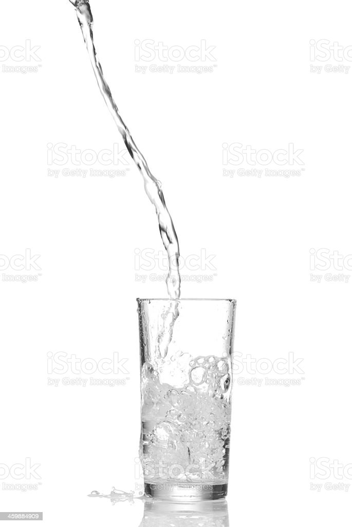 Water splashes in the glass stock photo