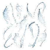 Different shaped water splashes are twisting and curving in different directions. The mid air shapes are isolated on a white background with clipping paths. The water is blue and transparent with droplets of water splashing either side of the main shapes.