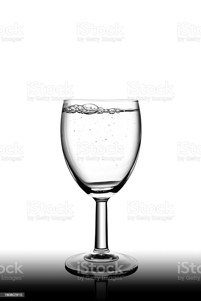 Water splashing in a glass royalty-free stock photo