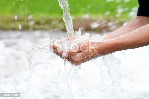 Water splashing in hands cupped