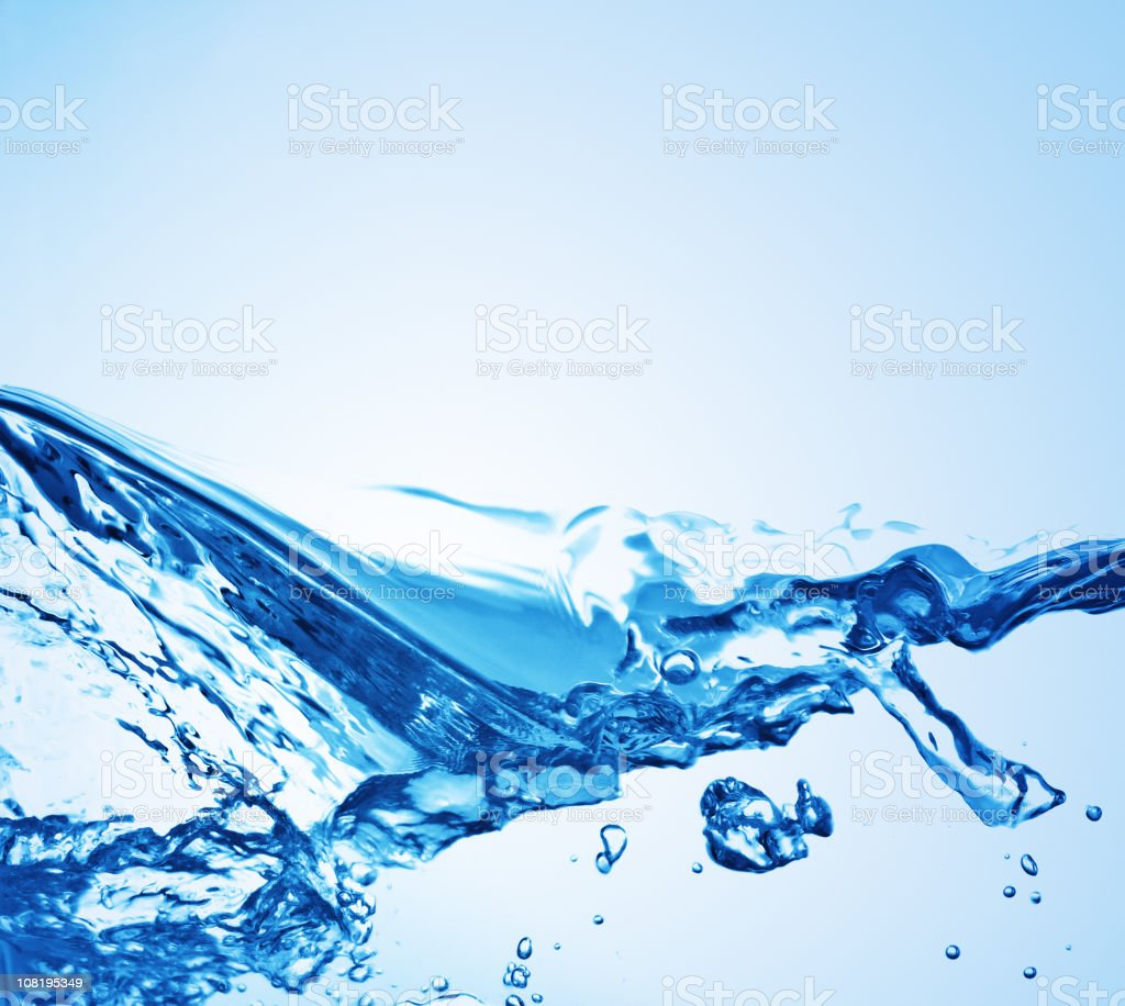 Water splashing on a blue background  royalty-free stock photo