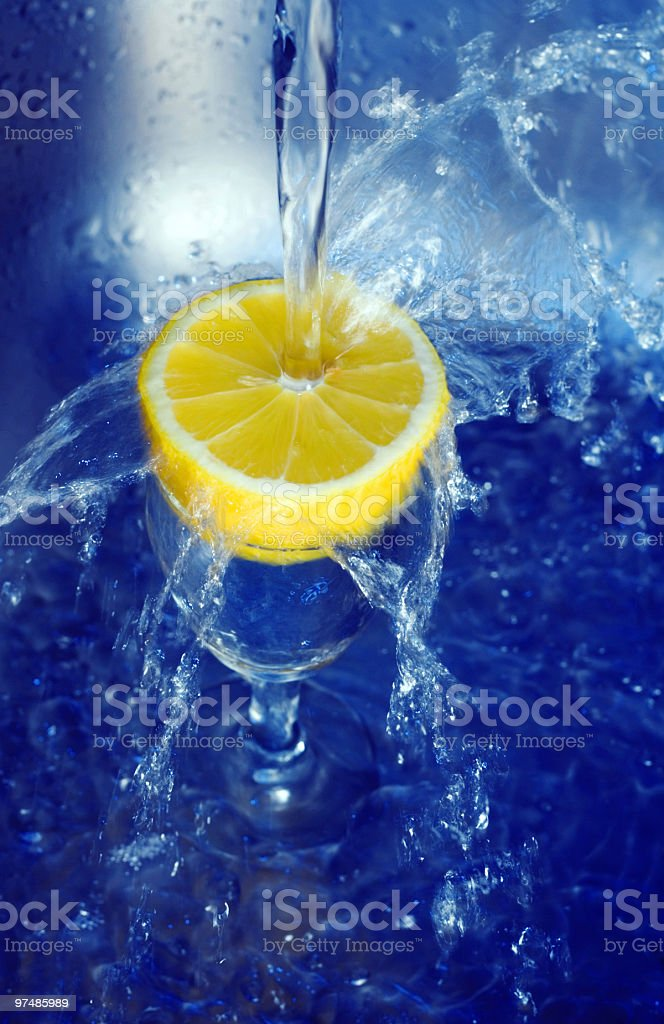 Water splashing on lemon royalty-free stock photo