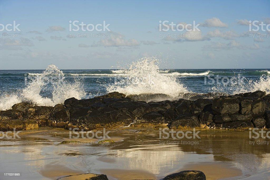 Water Splashing on Rocks at Beach stock photo