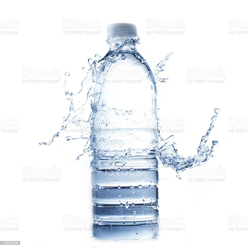 Water splashing onto full plastic water bottle stock photo