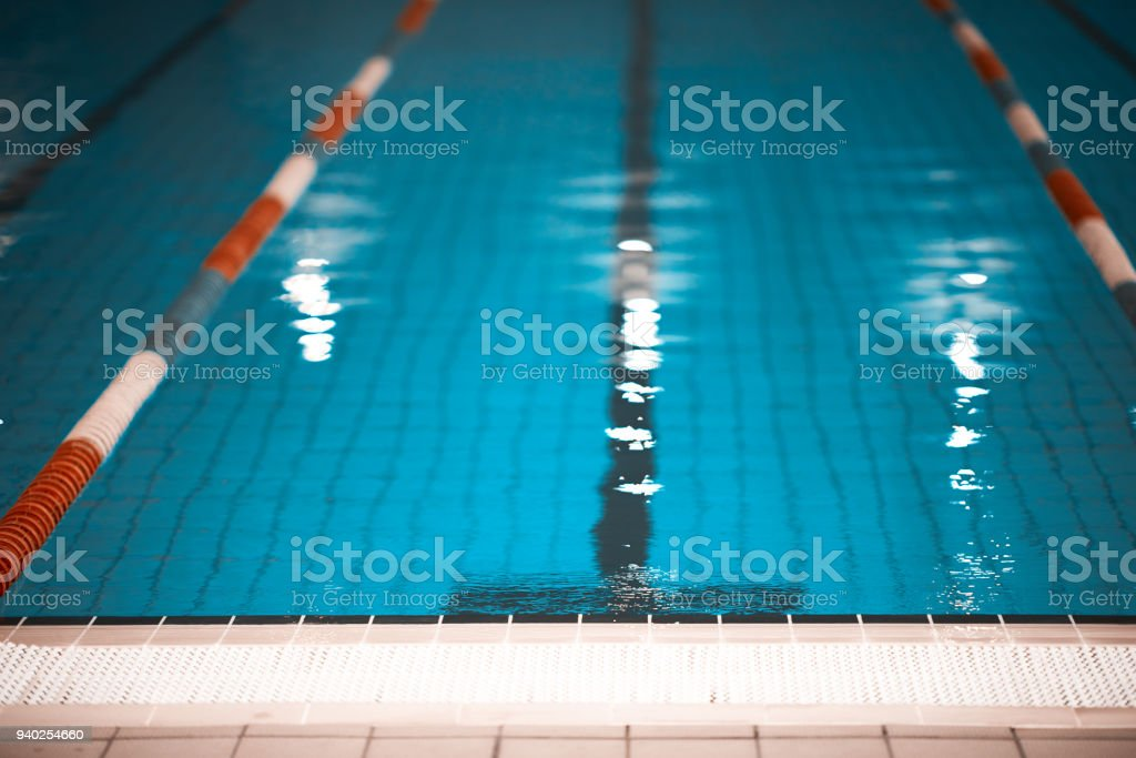 horizontal background of indoors swimming pool with swimming lane...