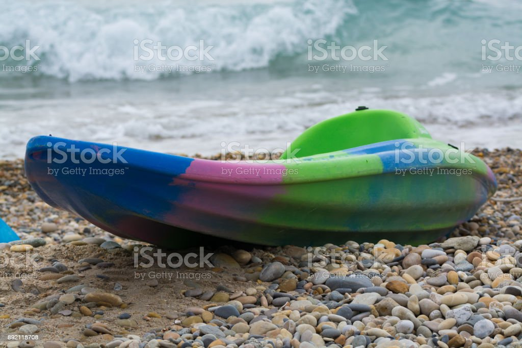 Water sport equipment - kayak on the beach, vacation leisure